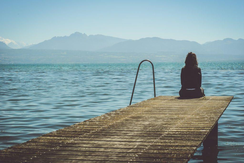 woman sitting on dock