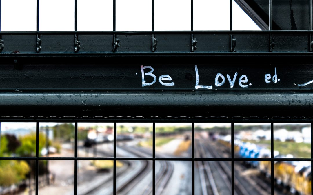 Be Love words on fence