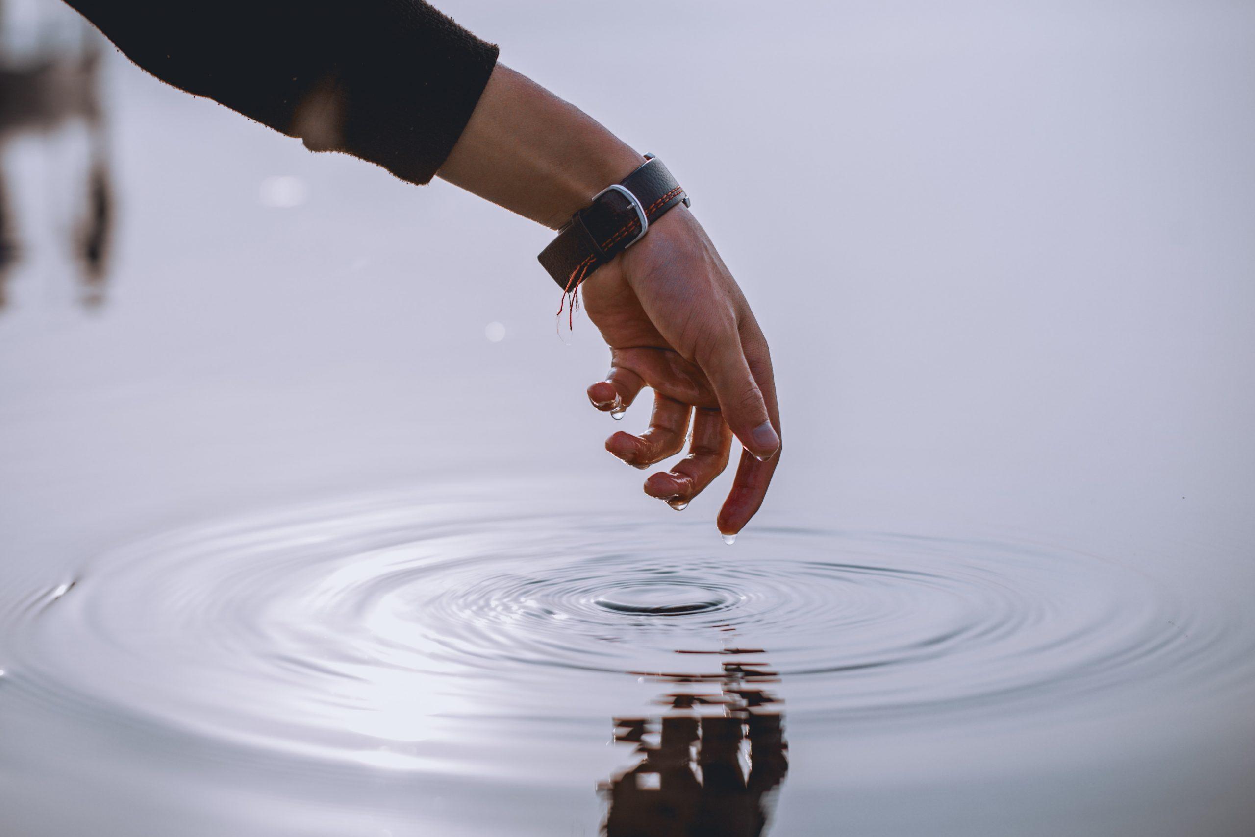 Finger touching water